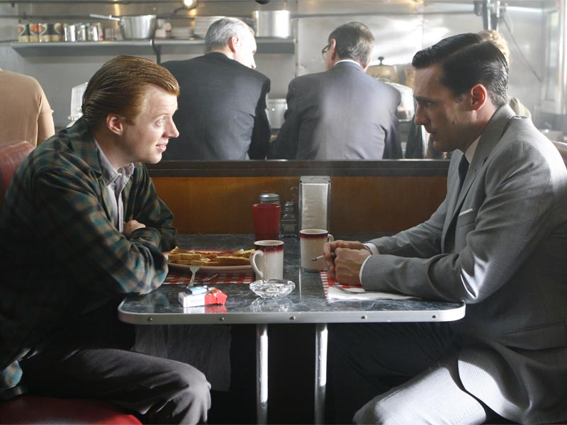 Adam Whitman (Jay Paulson) and Don Draper (Jon Hamm) - Mad Men - Season 1, Episode 5 - Photo Credit: Carin Baer/AMC