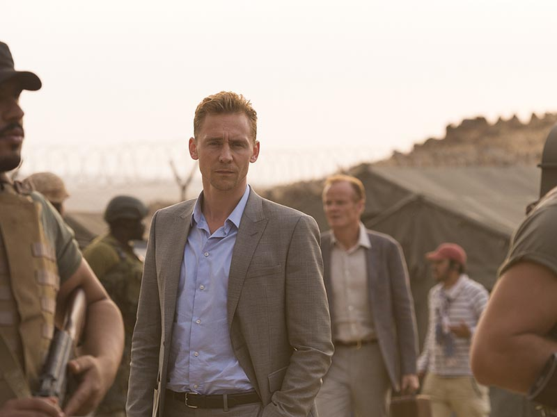 Tom Hiddleston as Jonathan Pine; Alistair Petrie as Sandy Langbourne; group- The Night Manager _ Season 1, Episode 5- Photo Credit: Des Willie/AMC