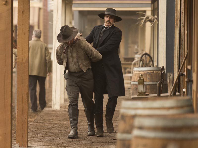 Jonathan C. Stewart as Wyatt Earp (right) - The American West _ Season 1, Episode 5 - Photo Credit: Michael Moriatis/AMC