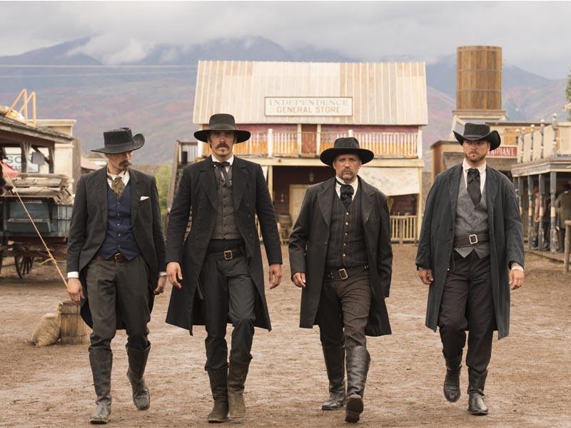 Edgar Fox as Doc Holliday, Jonathan C. Stewart as Wyatt Earp, Deacon Ledgers as Virgil Earp, Nick Bilas as Morgan Earp - The American West _ Season 1, Episode 7 - Photo Credit: Michael Moriatis/AMC