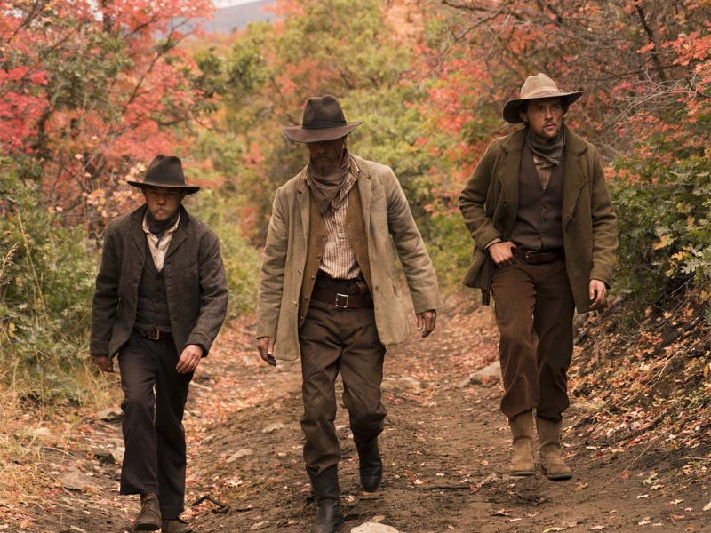 Nathan Stevens as Robert Ford, David H. Stevens as Jesse James, Samuel Dunning as Charley Ford - The American West _ Season 1, Episode 8 - Photo Credit: Michael Moriatis/AMC