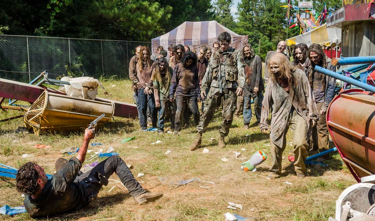 Rick Falls Into a Horde of Walkers in a Talked About Scene From <em>The Walking Dead</em> Season 7, Episode 12