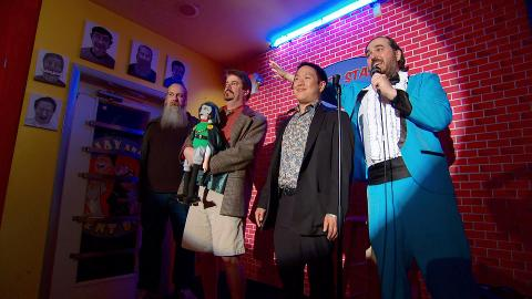The Comic Book Men organize and compete in a standup show at the Secret Stash, hosted by Brian Quinn.
