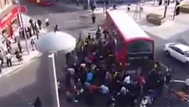 WATCH: London Crowd Lifts Double-Decker Bus off Trapped Cyclist