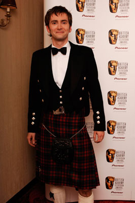 On the red carpet at the 2005 BAFTA TV Awards, Tennant nodded to his Scottish heritage by combining a traditional kilt with black-tie formality. Nice legs.