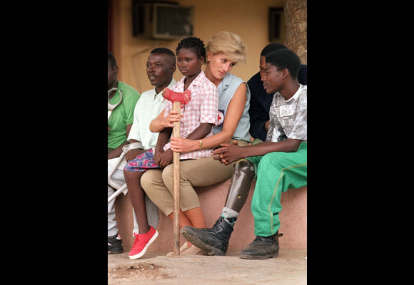 Fourteen years ago today, Diana, Princess of Wales, was killed in a Paris car crash that also took the lives of her partner Dodi Fayed and their driver Henri Paul. We take a look back at Diana's final months, which produced some of her most iconic shots, including the above photo of the Princess meeting with land mine victims in Angola. (AP Photo/Joao Silva)