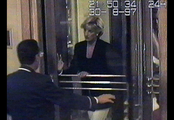 "In this security camera image captured just hours before the crash, Diana is seen arriving at the Ritz Hotel in Paris. ""During the evening the couple cancel a dinner engagement at a restaurant in the city,"" BBC News reported, ""because of the enormous press attention their presence has generated."" However, their plan was thwarted by paparazzi, and their attempt to evade photographers led to the fatal crash in the Paris tunnel. Diana was 36.  (AP Photo/APTV)"
