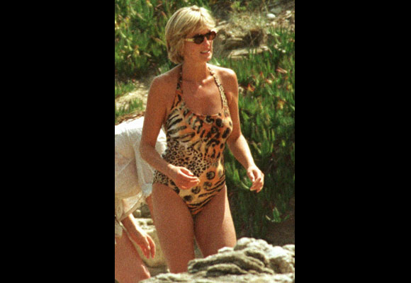 Diana dazzled onlookers in a feline print one-piece swimsuit while on holiday at Mohamed Al Fayed's residence in Saint Tropez on the French Riviera. At this time, Diana had just embarked on a romance with Al-Fayed's son, Dodi. (AP PHOTO/Lionel Cironneau)