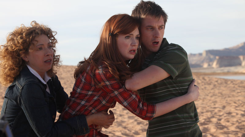 River Song and Rory restrain Amy.