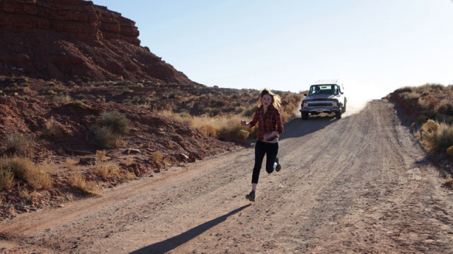 Amy runs from the car