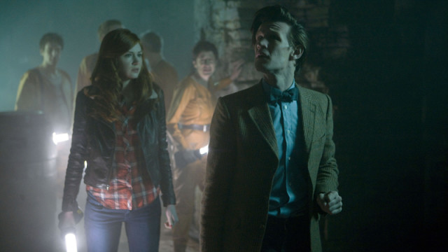 The Doctor and his companions with the factory workers