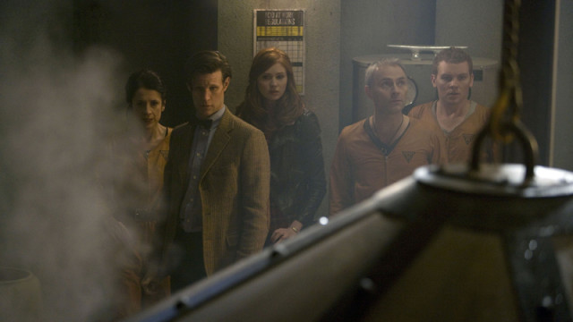 The Doctor and Amy with the factory crew