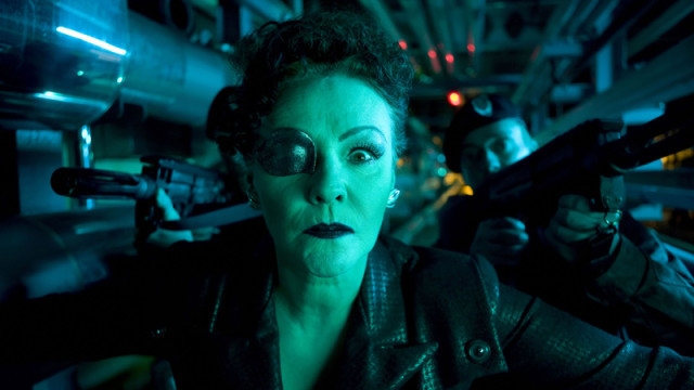 Madame Kovarian sports her eyepatch.