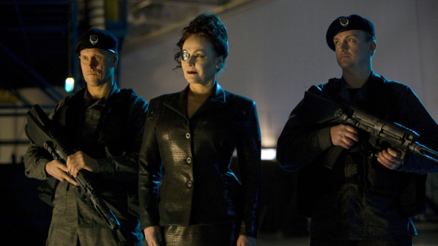 Madame Kovarian and her guards.