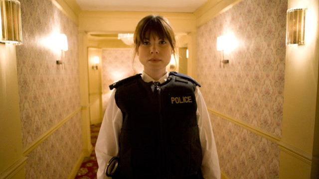A policewoman patrols the hallways.