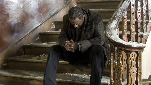Luther waits for Mark North on the stairs