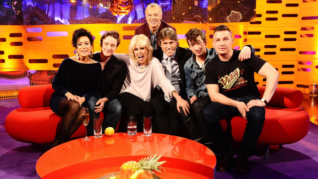 L-R: Graham strikes a pose with Nancy Dell'Olio, James McAvoy, Joanna Lumley, John Bishop and the Arctic Monkeys' Alex Turner and Jamie Cook.