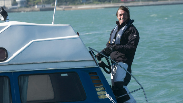 Richard steers his amphibious car