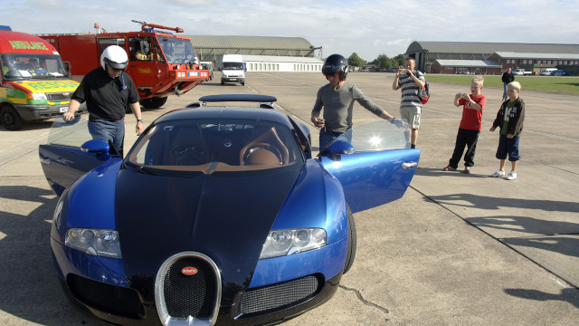 Richard gets in the two-toned Veyron.