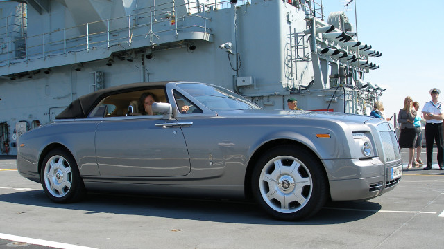 James waits in the Rolls-Royce Phantom Drophead.