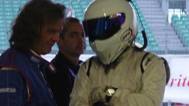 James and The Stig consult in the Top Gear pit