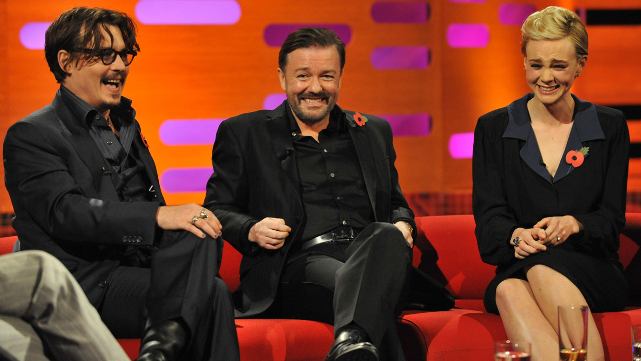 Trouble must be brewing: Johnny Depp, Ricky Gervais and Carey Mulligan snicker on set.
