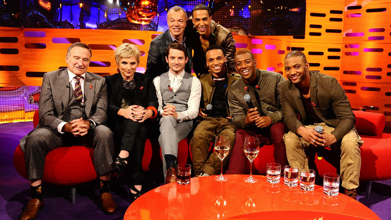 Tight squeeze: Graham's red couch is jam-packed with Robin Williams, Jennifer Saunders, Elijah Wood and JLS.