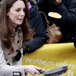 On a visit to a cancer charity center in Belfast, Kate flips a pancake. The Queen also made an historic visit to Northern Ireland this year, although as far as anyone knows, she didn't flip any pancakes. March 8. (AP Photo/Peter Morrison)