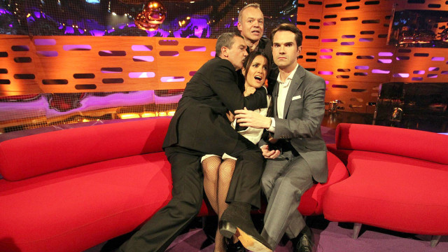 Group hug: Graham Norton, Antonio Banderas and Jimmy Carr get up close and personal with Salma Hayek.