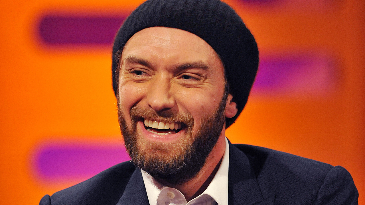 Jude Law's beanie hat is a hot topic for Graham.
