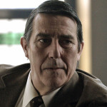 "Devoted to his work, Bland is obsessed with the UK's national security amidst the ongoing Cold War. Ciarán Hinds (The Debt) sees him as someone who ""pursues his ideas aggressively. He's direct, but he's also learned to play games. He senses opportunity when the power balance at the Circus suddenly shifts."" The loyal Circus stalwart is appropriately tagged as ""Soldier"" on the list of mole suspects."