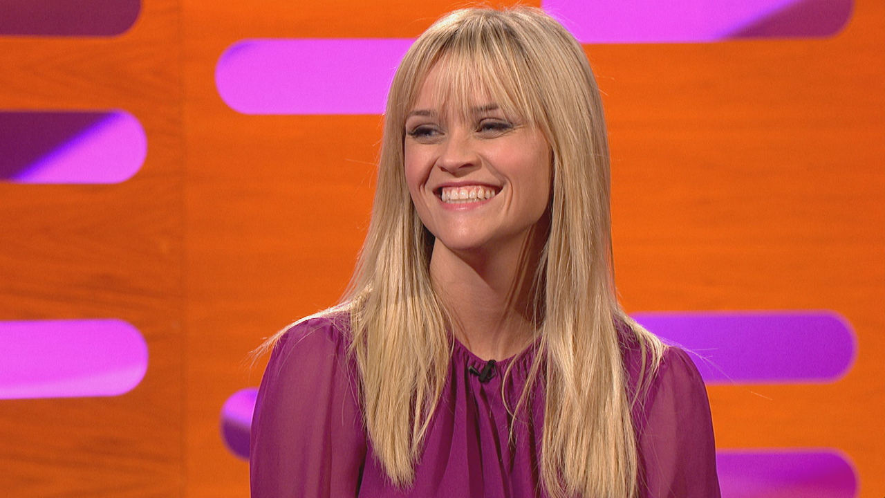 Reese Witherspoon laughs at Graham's inquiry about her bangs.