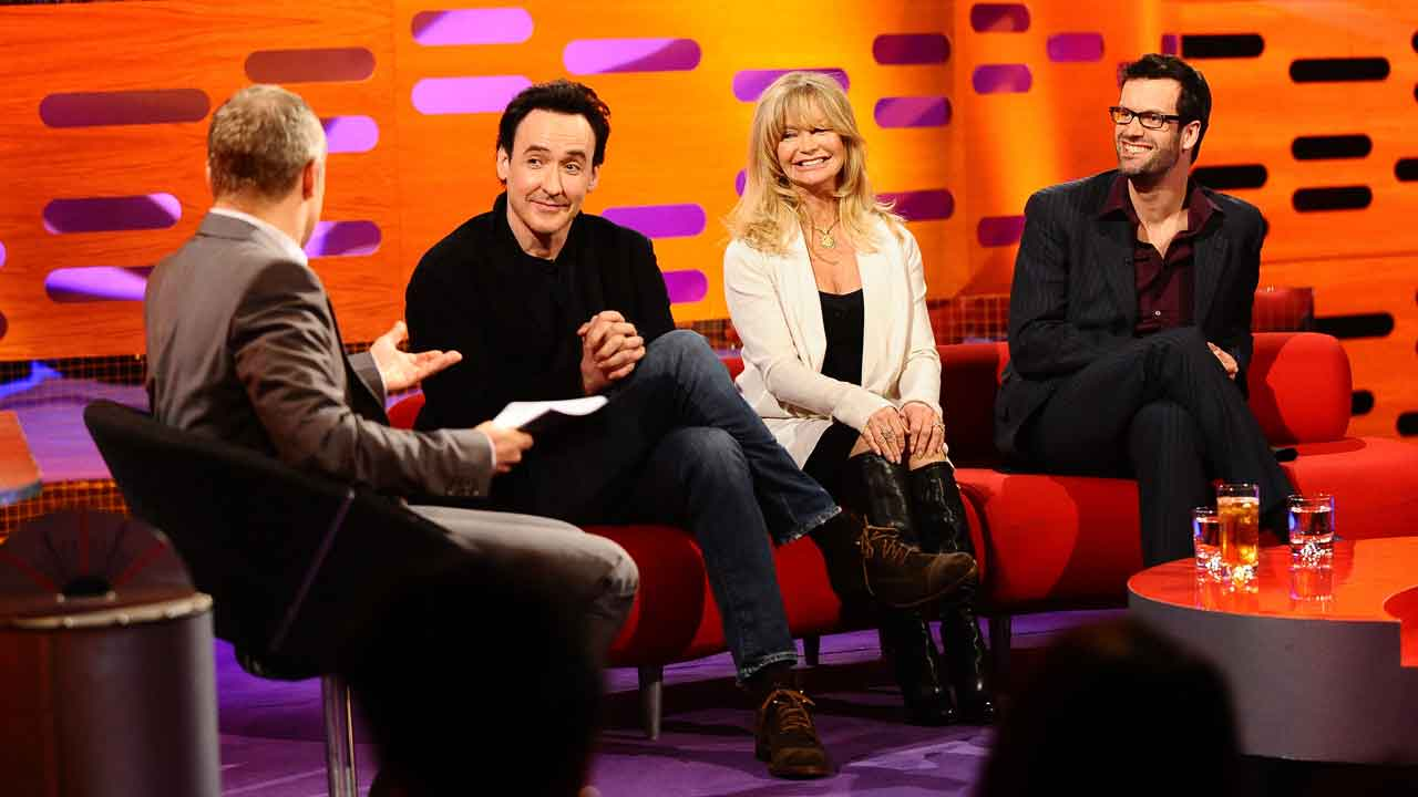 It's a royal laugh-in with John Cusack, Goldie Hawn and Marcus Brigstocke.