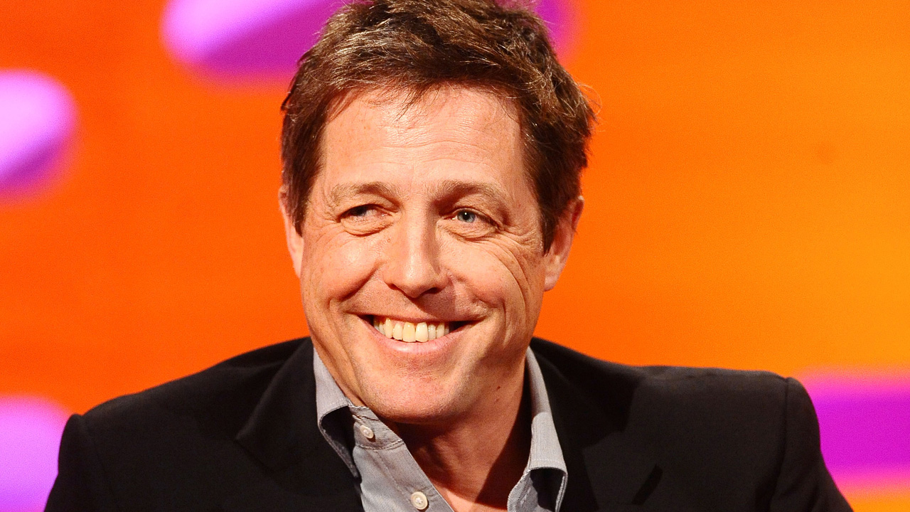 British actor Hugh Grant shows off his mega-watt smile!