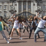 "As the press and the public hunger for images of the newlyweds, tourists at Buckingham Palace were treated to a surprise flashmob of more than 100 dancers. ""Our theme was Romeo and Juliet because of the royal wedding. It's just to celebrate Kate and William and their love,"" said one of the dancers. The event was secretly planned by Buckingham Palace. Watch video of the event here. (Rex Features/AP Images)"