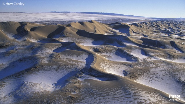 Snow covers the Gobi Desert in Mongolia.