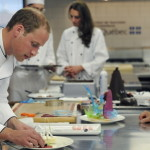 Will and Kate don chef's aprons to participate in a cooking workshop in Montreal on the third day of their Canadian tour. (David Rose/AP Images)