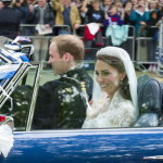"Prince William and his new bride are here shown on their way from Buckingham Palace to Clarence House after the wedding. ""It was Prince William's idea to drive his new bride away from the official reception on their first journey as a married couple to his family home,"" a palace spokesman told the Daily Mail. William drove a blue Aston Martin belonging to his father, Prince Charles, who reportedly later said, according to the BBC, that his son had forgotten to take the hand brake off for the ride. (Humphrey Nemar, Express Newspapers/AP Images)"