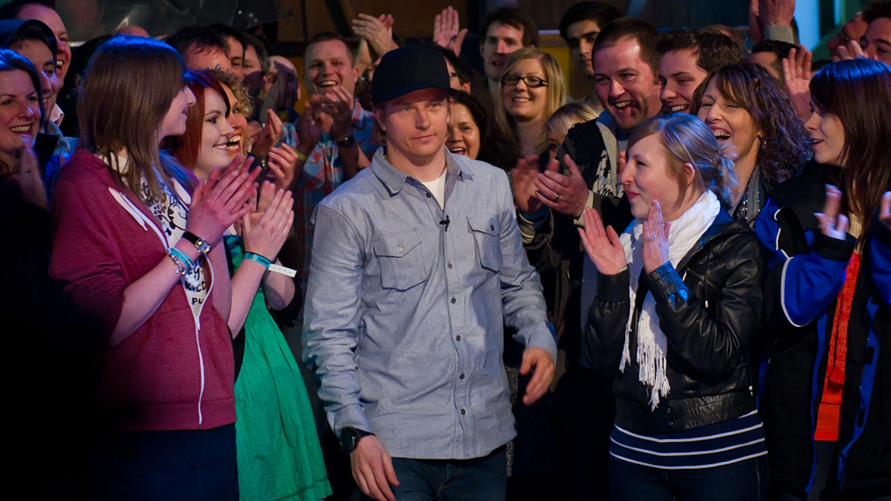 Racing driver Kimi Räikkönen gets a warm reception from the 'Top Gear' audience.