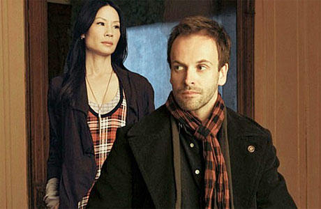 Lucy Liu and Jonny Lee Millar as Holmes and Watson in Elementary