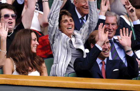 And here's our grand finale: William attempting a Mexican wave, and Kate looking on, looking amused/bemused/appalled (delete according to generosity of spirit). New balls, please! (Photo: AP)