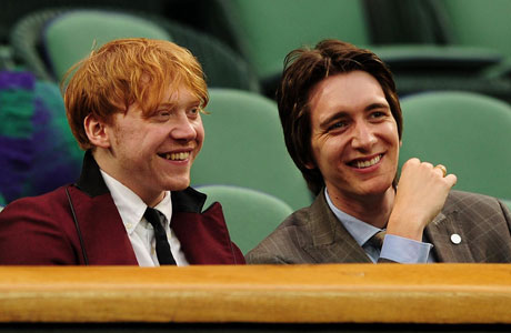 Ron and Fred Weasley (or is it George) enjoy a magical afternoon watching muggle tennis. (Photo: AP)