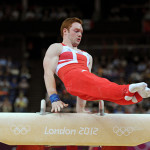 Team member Andrew Purvis on the pommel horse. (Press Association via AP Images)