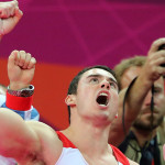 Great Britain's Kristian Thomas celebrates his team's medal. (Andrew Milligan/PA Wire; Press Association via AP Images)