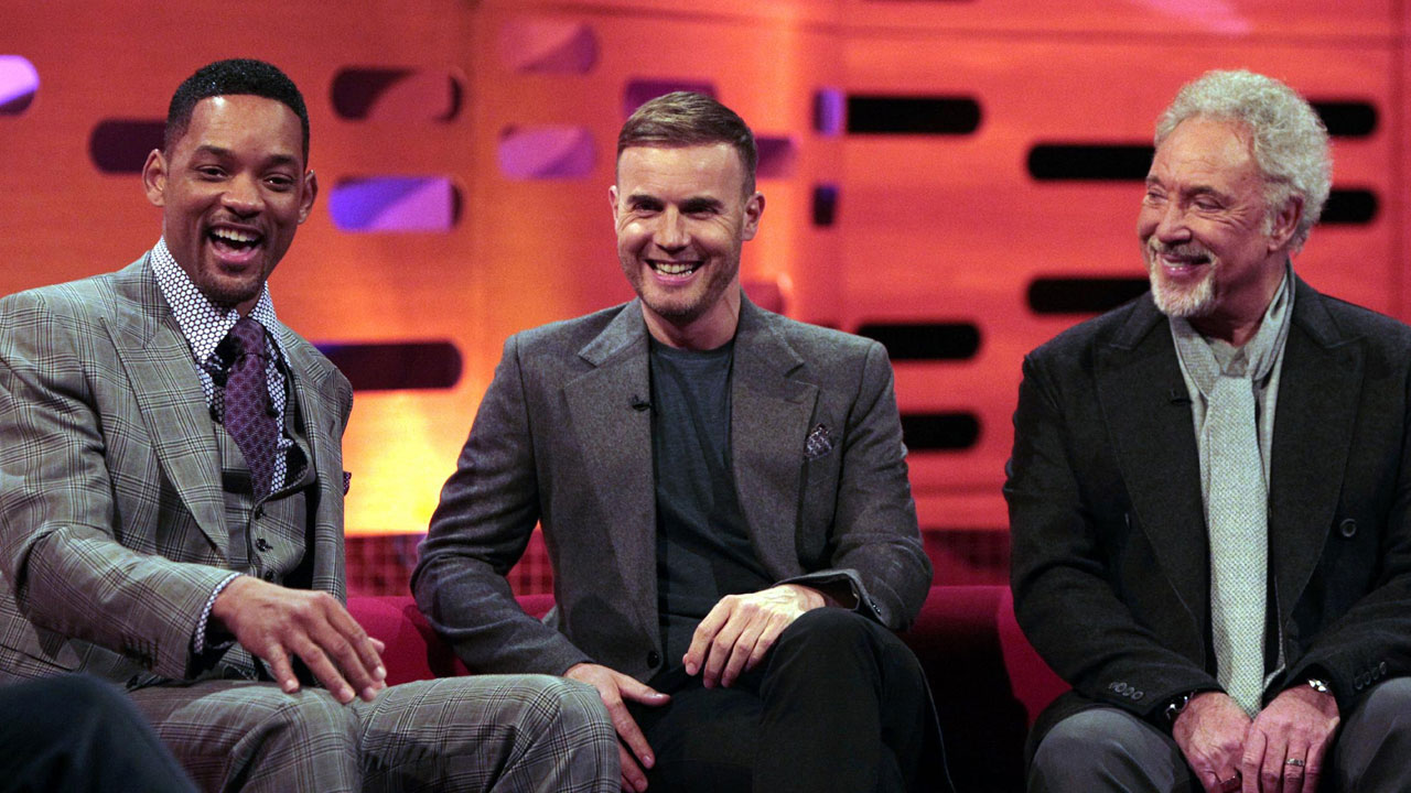 Will and Gary share a laugh on the famous red couch.