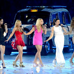 "The five original Spice Girls — Posh, Ginger, Baby, Sporty, and Scary — reunited and performed their signature songs, ""Wannabe"" and ""Spice Up Your Life,"" before an exuberant audience. (Rex Features via AP)"