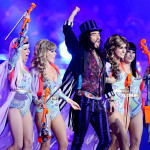 "Comedian Russell Brand, dressed up as Willy Wonka, dropped in to perform The Beatles' ""I Am the Walrus."" (Rex Features via AP)"