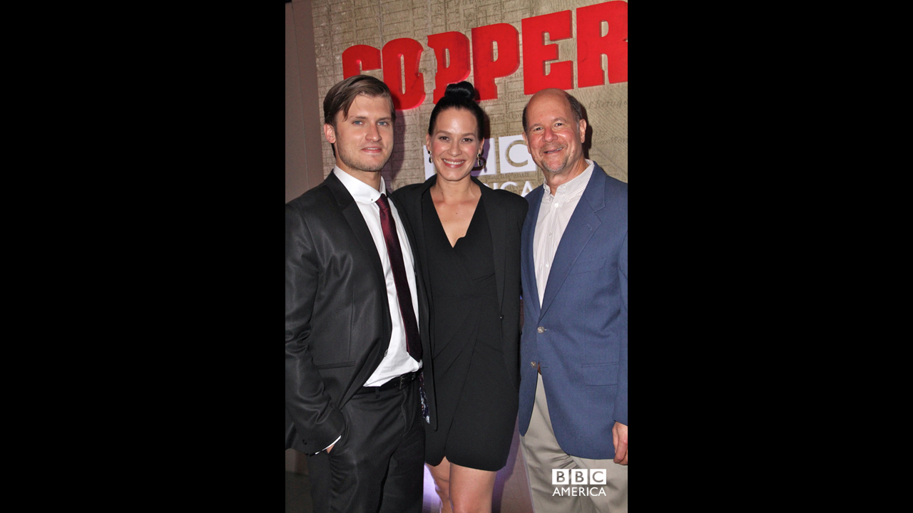 Tom Weston-Jones and Franka Potente pose with BBC America General Manager, Perry Simon.