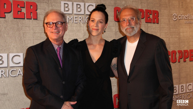 A lot of talent packed into one picture! Franka Potente steals a moment with the show Executive Producers Barry Levinson and Tom Fontana.