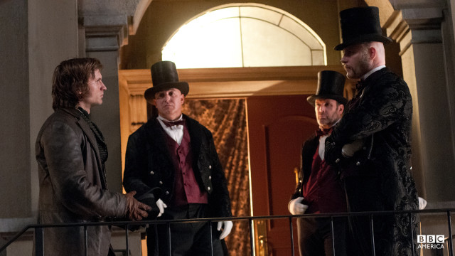 Detective Corcoran has a word with the doormen outside Madame Pompadou's Bordello, who he believes helped cover up a murder.